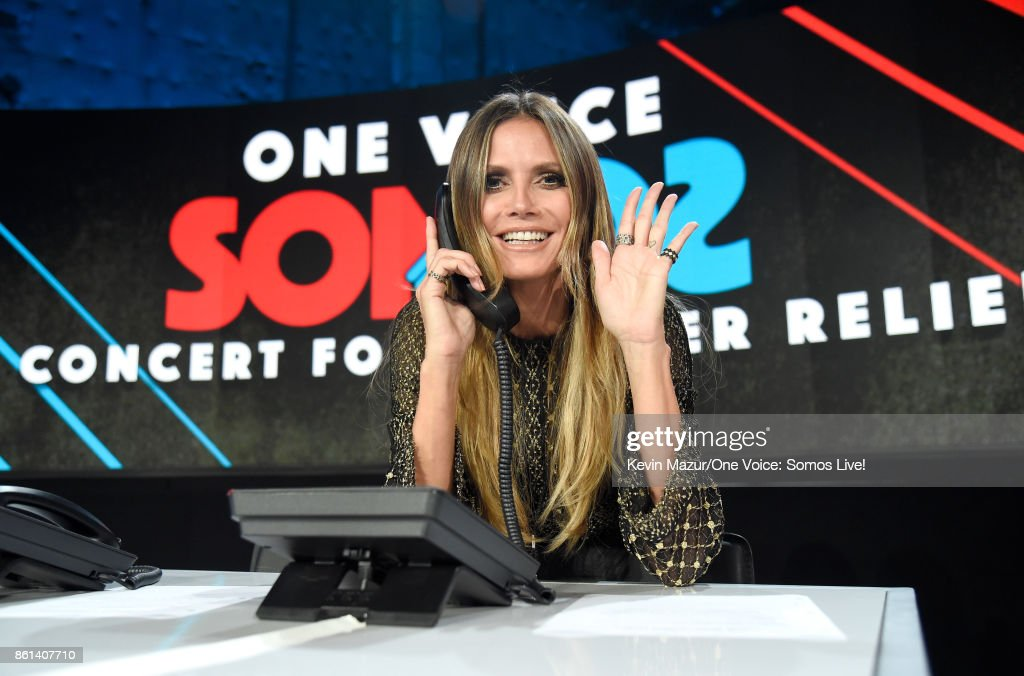 In this handout photo provided by One Voice: Somos Live!, Heidi Klum participates in the phone bank onstage during 'One Voice: Somos Live! A Concert For Disaster Relief' at the Universal Studios Lot on October 14, 2017 in Los Angeles, California.
