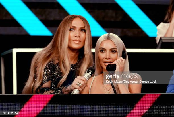 In this handout photo provided by One Voice Somos Live Jennifer Lopez and Kim Kardashian participate in the phone bank onstage during 'One Voice...
