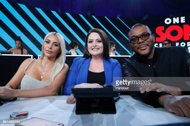 In this handout photo provided by One Voice Somos Live Kim Kardashian Lauren Ash and Tyler Perry participate in the phone bank during 'One Voice...