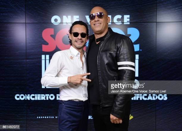 In this handout photo provided by One Voice Somos Live Marc Anthony and Vin Diesel pose in the pressroom at One Voice Somos Live A Concert For...