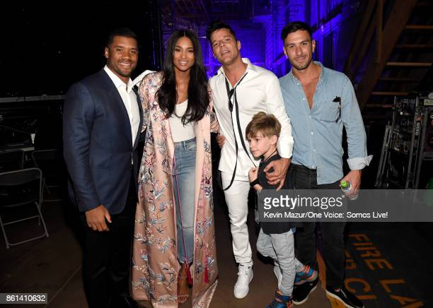 In this handout photo provided by One Voice Somos Live NFL player Russell Wilson singers Ciara and Ricky Martin and Jwan Yosef pose backstage during...