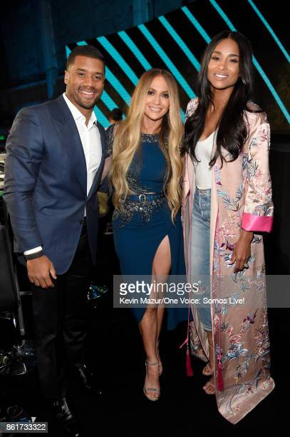In this handout photo provided by One Voice Somos Live NFL player Russell Wilson and singers Jennifer Lopez and Ciara pose backstage during 'One...