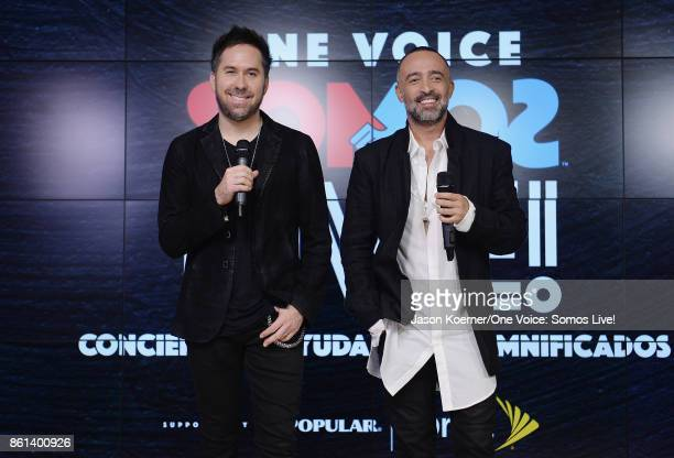 In this handout photo provided by One Voice Somos Live Pablo Hurtado and Mario Domm of 'Camila' pose in the pressroom at One Voice Somos Live A...