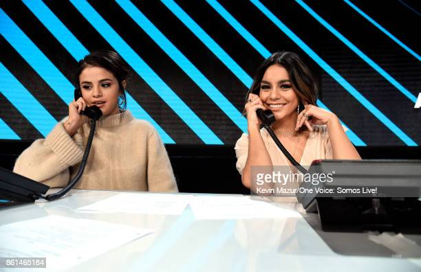 In this handout photo provided by One Voice Somos Live Selena Gomez and Vanessa Hudgens participate in the phone bank onstage during 'One Voice Somos...
