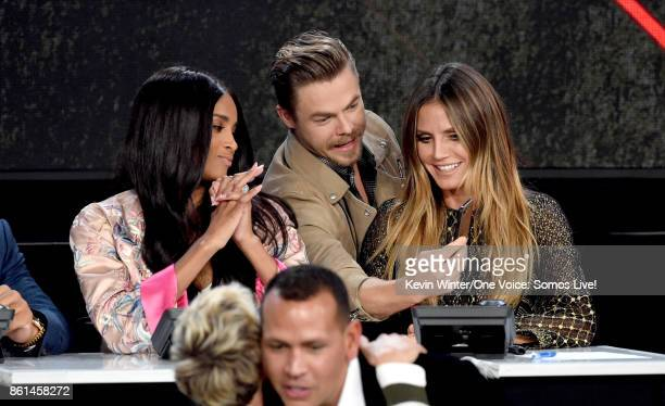 In this handout photo provided by One Voice Somos Live singer Ciara and tv personalities Derek Hough and Heidi Klum participate in the phone bank...
