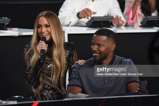 In this handout photo provided by One Voice Somos Live singer Jennifer Lopez and actor Jamie Foxx speak onstage during 'One Voice Somos Live A...