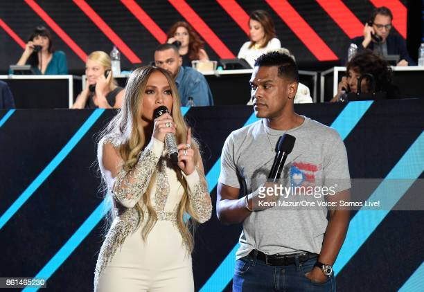 In this handout photo provided by One Voice Somos Live singers Jennifer Lopez and Maxwell speak onstage during 'One Voice Somos Live A Concert For...