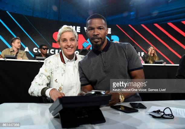 In this handout photo provided by One Voice Somos Live tv personality Ellen DeGeneres and actor Jamie Foxx participate in the phone bank onstage...