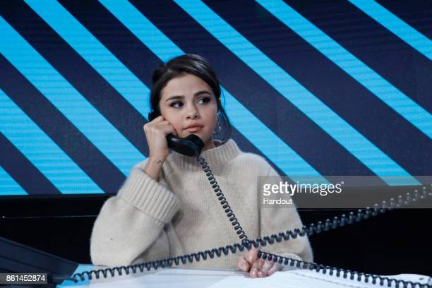 In this handout photo provided by One Voice Somos LiveSelena Gomez participates in the phone bank during 'One Voice Somos Live A Concert For Disaster...