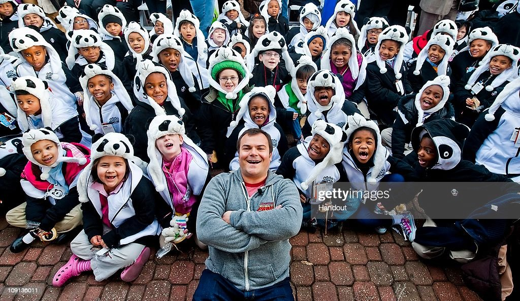 In this handout photo provided by Paramount Jack Black poses with school children after the naming ceremony of Zoo Atlanta's baby panda February 15...
