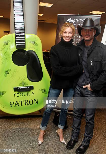 In this handout photo provided by Patron Faith Hill and Tim McGraw attend Patron Tequila celebration at the CMA's with a giant backstage guitar to be...
