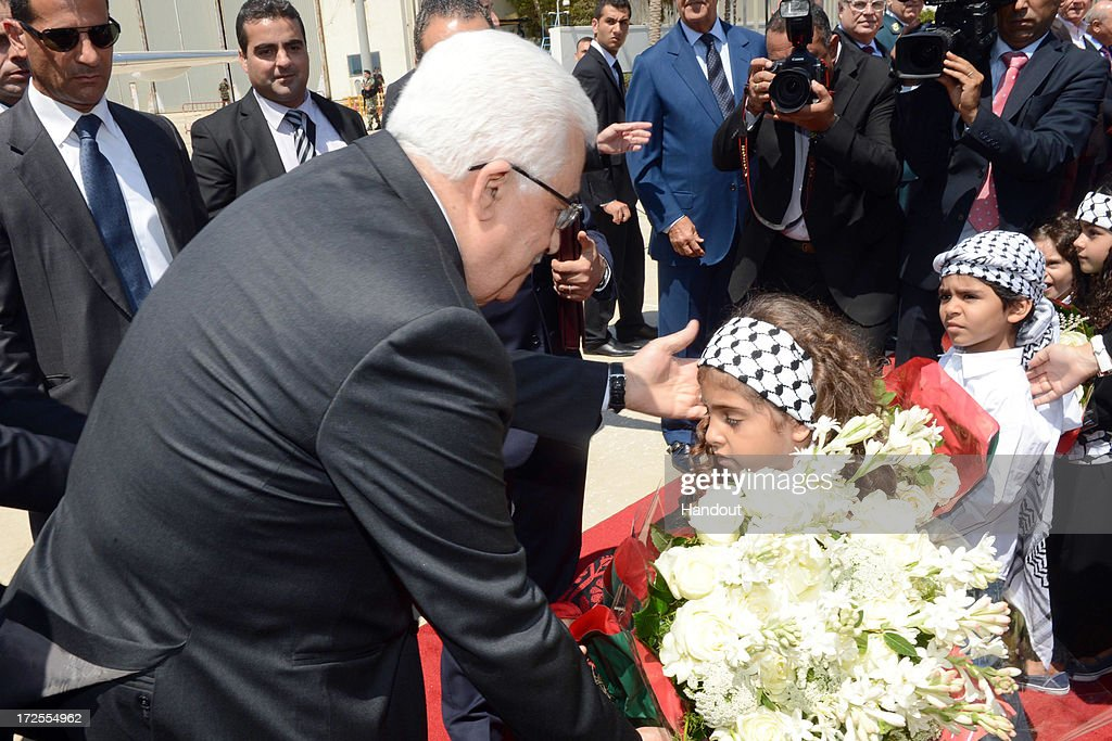 In this handout photo provided by PPO, Palestinian President <a gi-track='captionPersonalityLinkClicked' href=/galleries/search?phrase=Mahmoud+Abbas&family=editorial&specificpeople=176534 ng-click='$event.stopPropagation()'>Mahmoud Abbas</a> visits the Lebanese capital on July 3, 2013 in Beirut, Lebanon. Lebanon is now home to the largest number of Syrian refugees who have fled the conflict in that country. Both Lebanon and Syria have also historically hosted significant populations of Palestinian refugees.