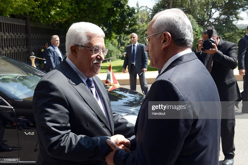In this handout photo provided by PPO, Palestinian President <a gi-track='captionPersonalityLinkClicked' href=/galleries/search?phrase=Mahmoud+Abbas&family=editorial&specificpeople=176534 ng-click='$event.stopPropagation()'>Mahmoud Abbas</a> (L) meets with Lebanese President General Michel Suleiman on July 3, 2013 in Beirut, Lebanon. Lebanon is now home to the largest number of Syrian refugees who have fled the conflict in that country. Both Lebanon and Syria have also historically hosted significant populations of Palestinian refugees.