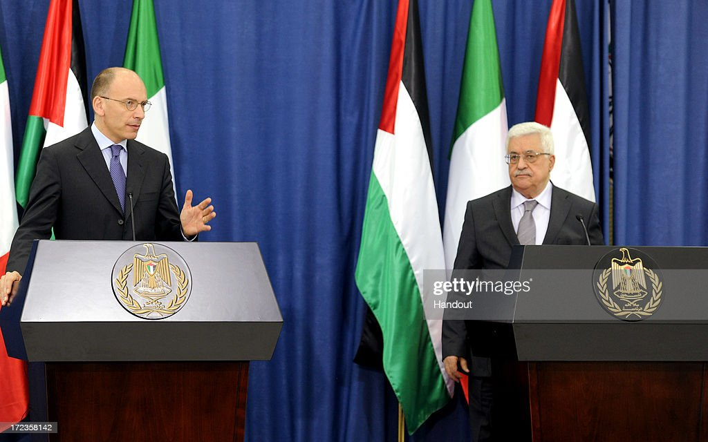 In this handout photo provided by PPO, President Mahmoud Abbas (L) and Italian Prime Minister, Enrico Letta address the media on July 2, 2013 in Ramallah, West Bank. In a joint media conference with the Italian Prime Minister, Mahmoud Abbas stated that after a meeting with U.S. Secretary of State John Kerry 2 days ago, that he is optimistic that the U.S. will succeed in restarting Israeli-Palestinian peace talks.
