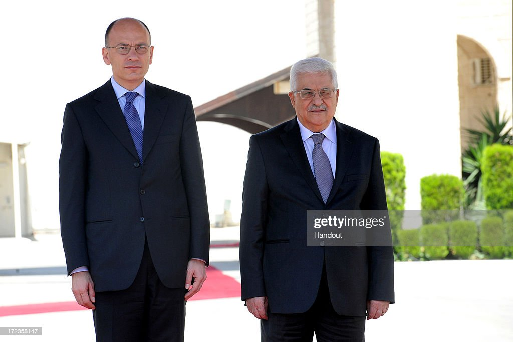 In this handout photo provided by PPO, President Mahmoud Abbas (R) meets with Italian Prime Minister, Enrico Letta (L) on July 2, 2013 in Ramallah, West Bank. In a joint media conference with the Italian Prime Minister, Mahmoud Abbas stated that after a meeting with U.S. Secretary of State John Kerry two days ago, that he is optimistic that the U.S. will succeed in restarting Israeli-Palestinian peace talks.