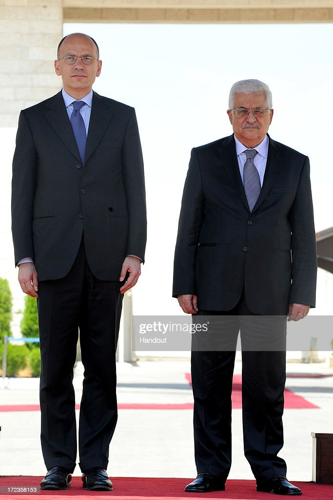 In this handout photo provided by PPO, President <a gi-track='captionPersonalityLinkClicked' href=/galleries/search?phrase=Mahmoud+Abbas&family=editorial&specificpeople=176534 ng-click='$event.stopPropagation()'>Mahmoud Abbas</a> (R) meets with Italian Prime Minister, <a gi-track='captionPersonalityLinkClicked' href=/galleries/search?phrase=Enrico+Letta&family=editorial&specificpeople=2915592 ng-click='$event.stopPropagation()'>Enrico Letta</a> (L) on July 2, 2013 in Ramallah, West Bank. In a joint media conference with the Italian Prime Minister, <a gi-track='captionPersonalityLinkClicked' href=/galleries/search?phrase=Mahmoud+Abbas&family=editorial&specificpeople=176534 ng-click='$event.stopPropagation()'>Mahmoud Abbas</a> stated that after a meeting with U.S. Secretary of State John Kerry two days ago, that he is optimistic that the U.S. will succeed in restarting Israeli-Palestinian peace talks.