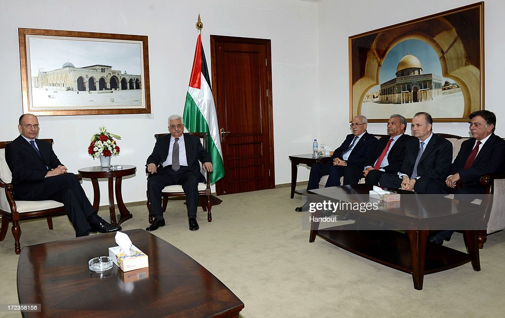 In this handout photo provided by PPO, President <a gi-track='captionPersonalityLinkClicked' href=/galleries/search?phrase=Mahmoud+Abbas&family=editorial&specificpeople=176534 ng-click='$event.stopPropagation()'>Mahmoud Abbas</a> (2nd L) meets with Italian Prime Minister, <a gi-track='captionPersonalityLinkClicked' href=/galleries/search?phrase=Enrico+Letta&family=editorial&specificpeople=2915592 ng-click='$event.stopPropagation()'>Enrico Letta</a> (L) on July 2, 2013 in Ramallah, West Bank. In a joint media conference with the Italian Prime Minister, <a gi-track='captionPersonalityLinkClicked' href=/galleries/search?phrase=Mahmoud+Abbas&family=editorial&specificpeople=176534 ng-click='$event.stopPropagation()'>Mahmoud Abbas</a> stated that after a meeting with U.S. Secretary of State John Kerry two days ago, that he is optimistic that the U.S. will succeed in restarting Israeli-Palestinian peace talks.