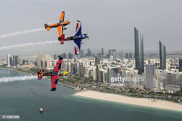 In this handout photo provided by Red Bull Matt Hall of Australia leads Kirby Chambliss of the United States and Nicolas Ivanoff of France over the...