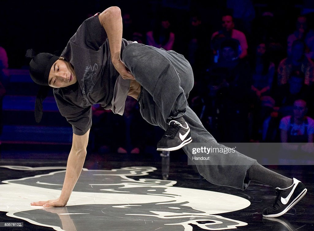 In this handout photo provided by Red Bull, Wing of Korea performs during the Red Bull BC One breakdance competition on November 5, 2008 in Paris, France. Sixteen of the world's best B-Boys compete in one-on-one knockout battles to determine the winner.