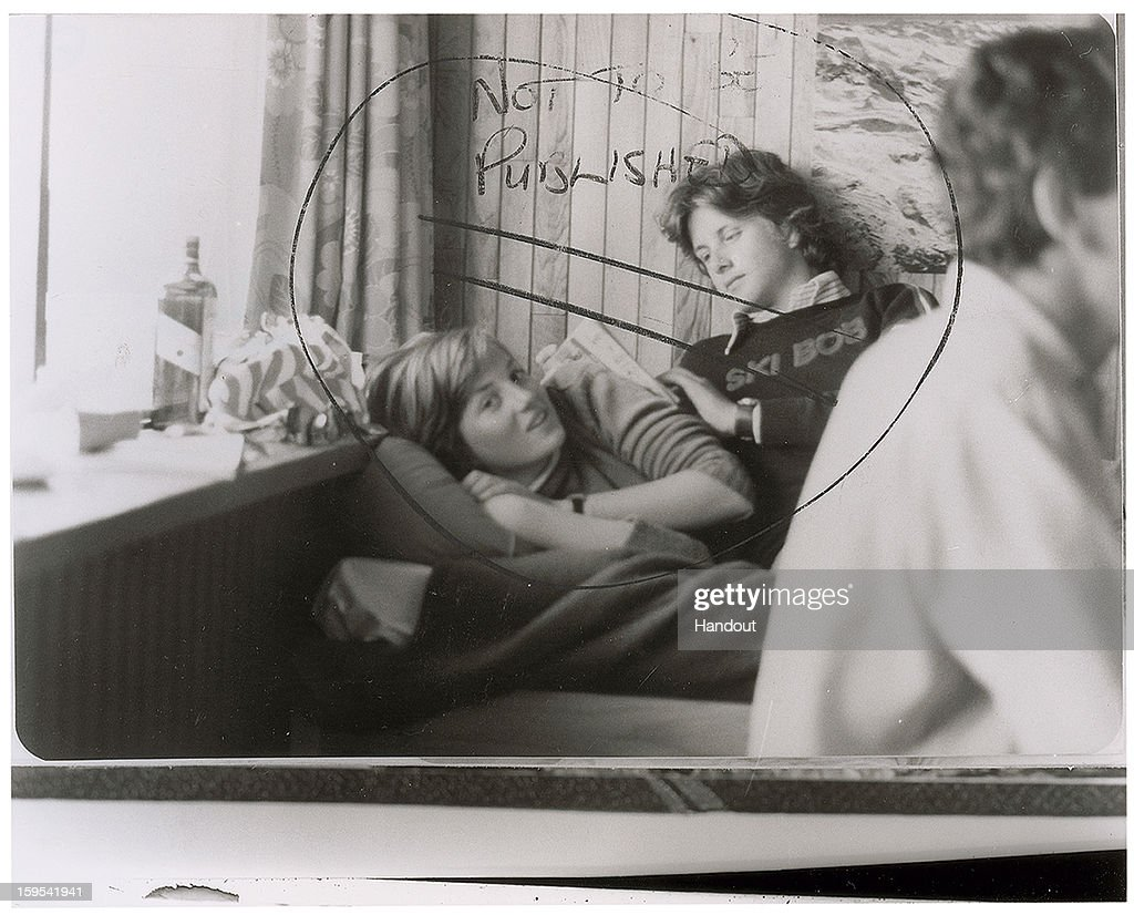 In this handout photo provided by RR Auction, a teenage image of the future Princess of Wales and Adam Russell emphatically labeled 'not to be published,' will be featured in an upcoming Photography auction, from New Hampshire based RR Auction in January. This early glossy news photo of a young Diana lying in bed, with a friend seated behind her, is stamped February 1981 on the back side. The auction will begin January 17 and runs through January 24.