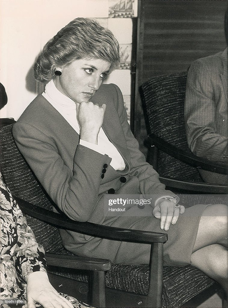 In this handout photo provided by RR Auction, an original 1988 news photo of Princess Diana observing a marriage conflict resolution seminar. The auction will begin January 17 and runs through January 24.