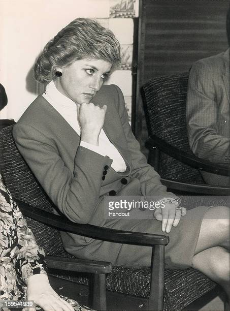 In this handout photo provided by RR Auction an original 1988 news photo of Princess Diana observing a marriage conflict resolution seminar The...