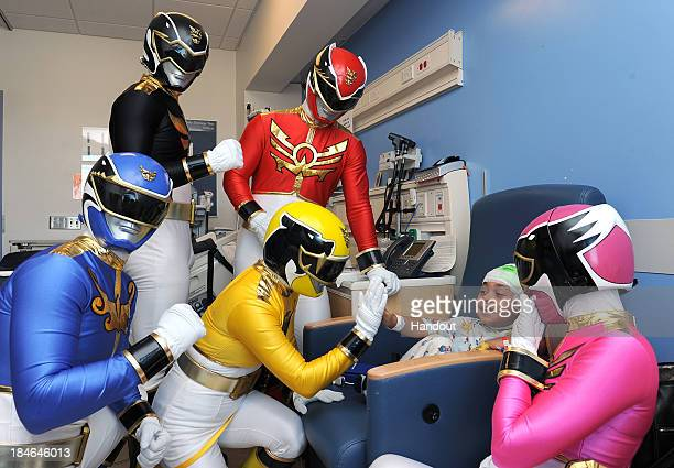 In this handout photo provided by Saban Brands the Power Rangers Megaforce visit and entertain a young hospital patient at Mattel Children's Hospital...
