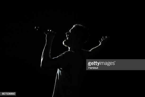 In this handout photo provided by Singapore GP Dan Reynolds of Imagine Dragons performs on stage during day three of the Singapore Formula One Grand...