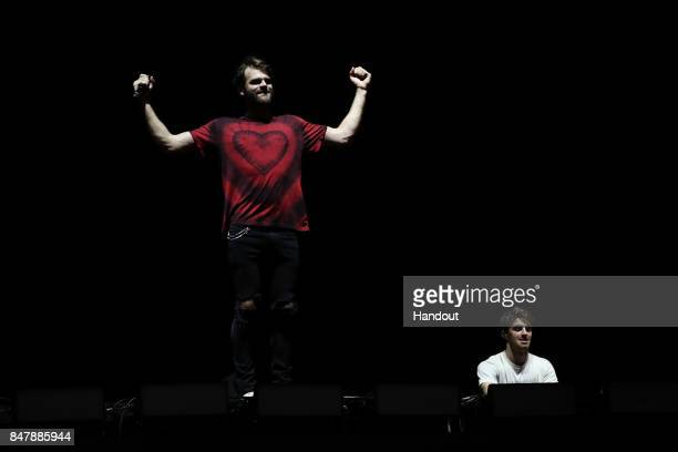 In this handout photo provided by Singapore GP Drew Taggart and Alex Pall of The Chainsmokers perform on stage during day two of the Singapore...