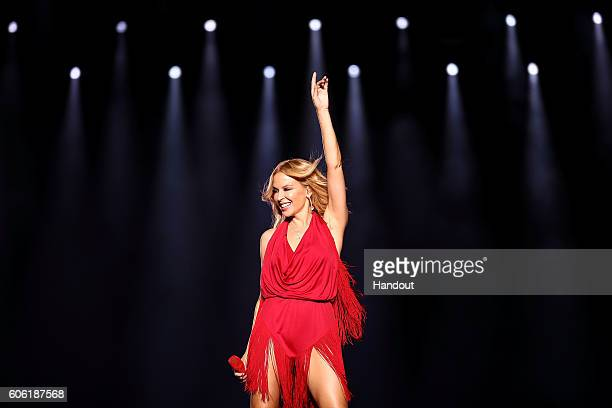 In this handout photo provided by Singapore GP Kylie Minogue performs on stage during day one of the Singapore Formula One Grand Prix at Marina Bay...