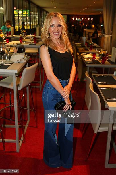 In this handout photo provided by Singapore GP Kylie Minogue poses in the Formula One Paddock Club on day two of the Singapore Formula One Grand Prix...