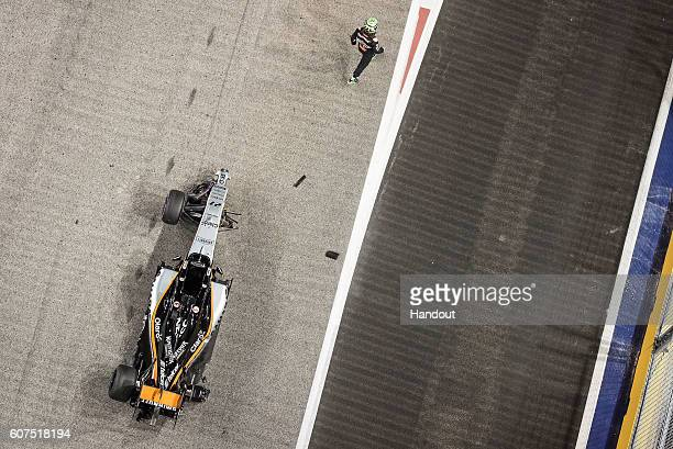In this handout photo provided by Singapore GP Nico Hulkenberg of Germany driving the Sahara Force India F1 Team VJM09 Mercedes PU106C Hybrid turbo...