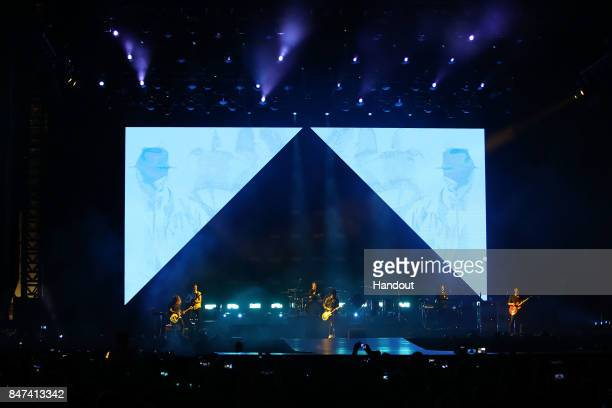 In this handout photo provided by Singapore GP Ryan Tedder of OneRepublic perform on stage during day one of the Singapore Formula One Grand Prix at...