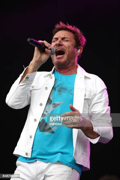 In this handout photo provided by Singapore GP Simon Le Bon of Duran Duran performs on stage during day four of the Singapore Formula One Grand Prix...