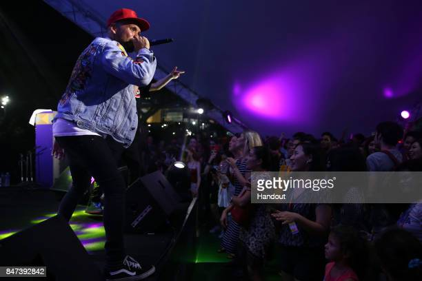 In this handout photo provided by Singapore GP THELIONCITYBOY performs on stage during day one of the Singapore Formula One Grand Prix at Marina Bay...