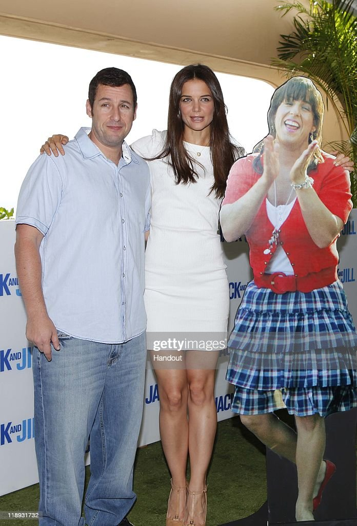 In this handout photo provided by Sony Pictures Entertainment, <a gi-track='captionPersonalityLinkClicked' href=/galleries/search?phrase=Adam+Sandler&family=editorial&specificpeople=202205 ng-click='$event.stopPropagation()'>Adam Sandler</a> and <a gi-track='captionPersonalityLinkClicked' href=/galleries/search?phrase=Katie+Holmes&family=editorial&specificpeople=201598 ng-click='$event.stopPropagation()'>Katie Holmes</a> attend the 'Jack and Jill' photocall at Summer of Sony 3 on July 10, 2011 in Cancun, Mexico on July 10, 2011 in Cancun, Mexico.