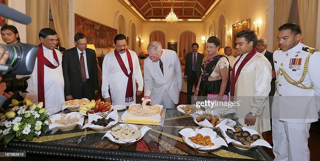 In this handout photo provided by Sri Lankan Government, <a gi-track='captionPersonalityLinkClicked' href=/galleries/search?phrase=Prince+Charles&family=editorial&specificpeople=160180 ng-click='$event.stopPropagation()'>Prince Charles</a>, Prince of Wales (C) cuts his birthday cake with Sri Lankan President <a gi-track='captionPersonalityLinkClicked' href=/galleries/search?phrase=Mahinda+Rajapaksa&family=editorial&specificpeople=588377 ng-click='$event.stopPropagation()'>Mahinda Rajapaksa</a> (4th L) during a reception at the President's House on November 14, 2013 in Colombo, Sri Lanka. The Royal couple are visiting Sri Lanka in order to attend the 2013 Commonwealth Heads of Government Meeting.