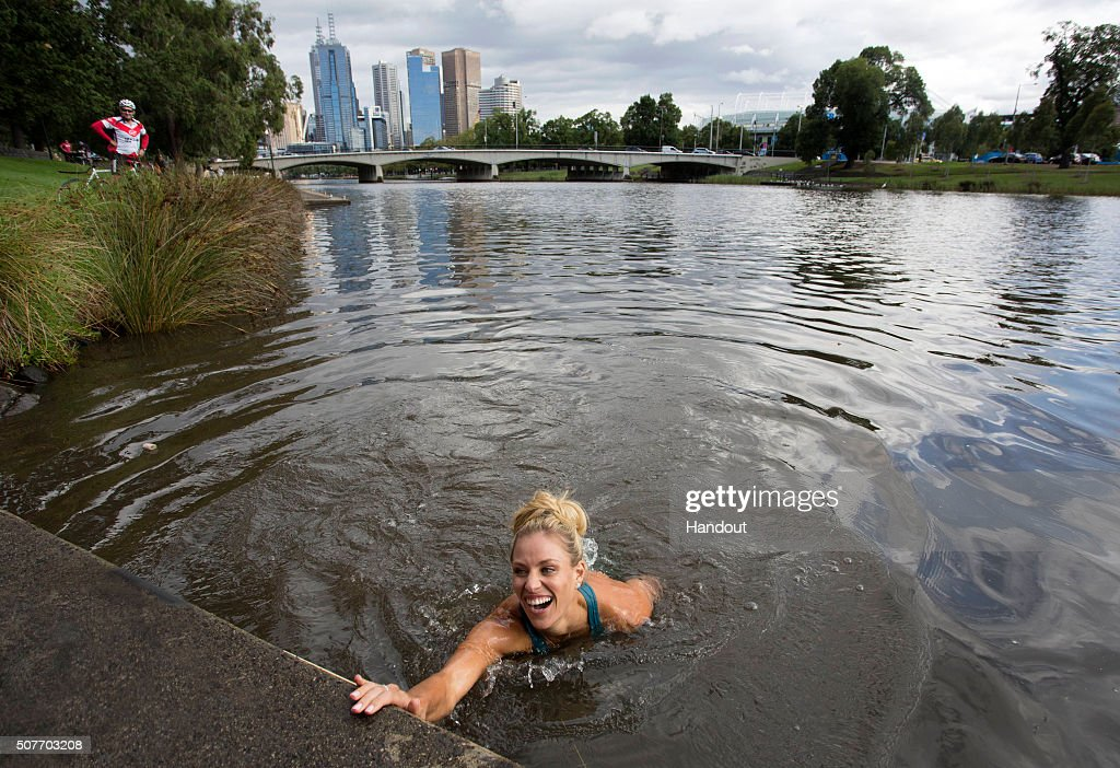 In this handout photo provided by Tennis Australia, Angelique Kerber of Germany jumps into the Yarra River on day 14 of the 2016 Australian Open at Melbourne Park on January 31, 2016 in Melbourne, Australia. Kerber defeated Serena Williams of the United States to win the Australian Women's Singles Final.