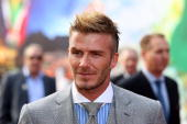 In this handout photo provided by the 2010 FIFA World Cup Organising Committee David Beckham speaks to journalists and fans sttends the Red Carpet...