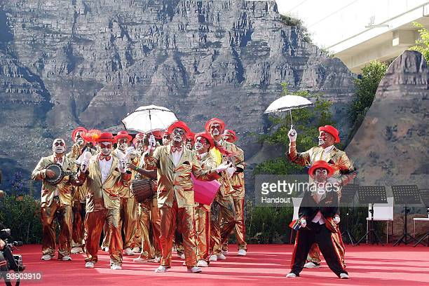 In this handout photo provided by the 2010 FIFA World Cup Organising Committee The Cape Minstrels leading the way sttends the Red Carpet event prior...