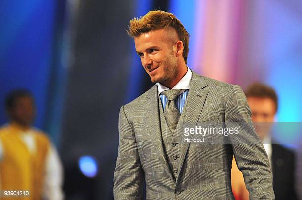 In this handout photo provided by the 2010 FIFA World Cup Organising Committee David Beckham attends the 2010 Soccer World Cup Final Draw at the...