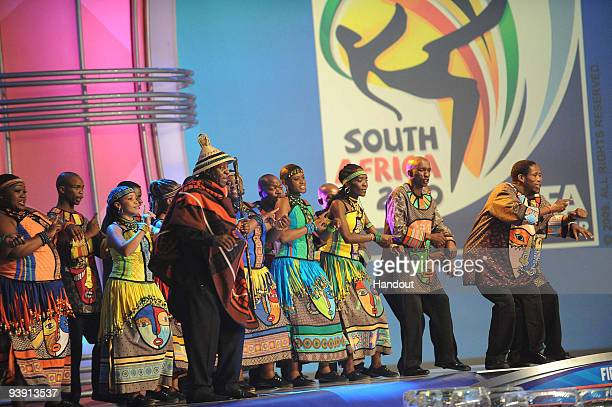 In this handout photo provided by the 2010 FIFA World Cup Organising Committee Tshepo Tshola with the Soweto Gospel Choir during the 2010 Soccer...