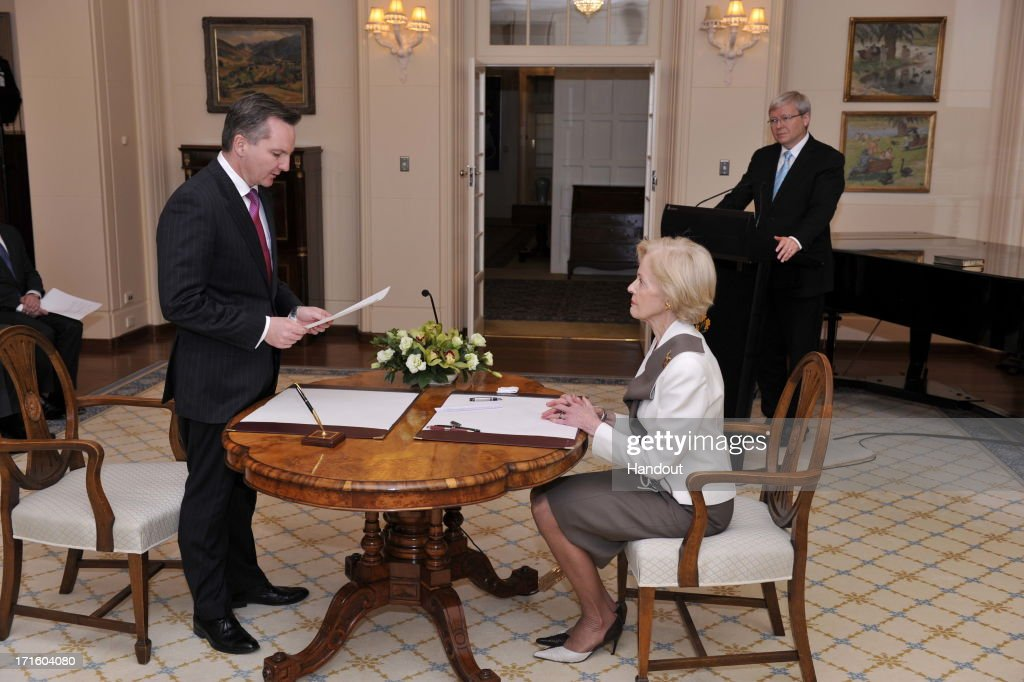 In this handout photo provided by the AUSPIC, Chris Bowen is sworn in to the role of Treasurer of Australia, by the Governor-General <a gi-track='captionPersonalityLinkClicked' href=/galleries/search?phrase=Quentin+Bryce&family=editorial&specificpeople=2602196 ng-click='$event.stopPropagation()'>Quentin Bryce</a> at Government House, on June 27, 2013 in Canberra, Australia. Kevin Rudd won an Australian Labor Party leadership ballot 57-45 last night, and was sworn in this morning as Australian Prime Minister by Governor-General <a gi-track='captionPersonalityLinkClicked' href=/galleries/search?phrase=Quentin+Bryce&family=editorial&specificpeople=2602196 ng-click='$event.stopPropagation()'>Quentin Bryce</a>. Rudd was Prime Minister from 2007 to 2010 before he was dumped by his party for his deputy Julia Gillard. Gillard has announced that she will leave parliament and not contest her seat following her ballot loss.