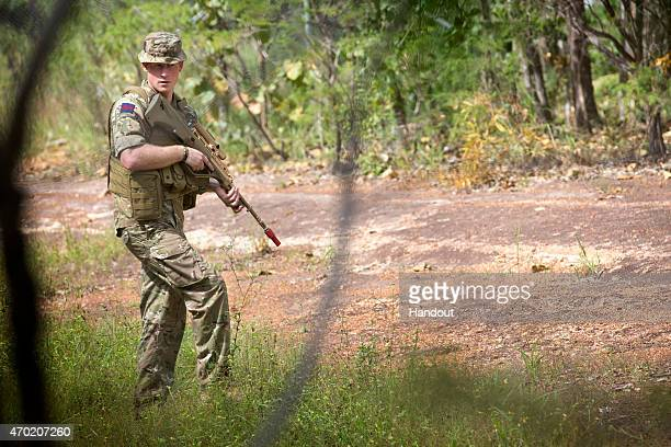 In this handout photo provided by the Australian Defence Force Prince Harry patrols during Exercise Thunder Observer a Joint Fire Team exercise with...