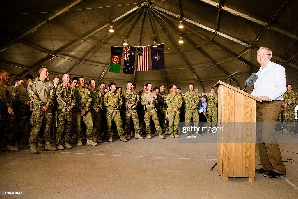 In this handout photo provided by the Australian Department of Defence Australian Prime Minister Kevin Rudd addresses troops at Multi National Base...