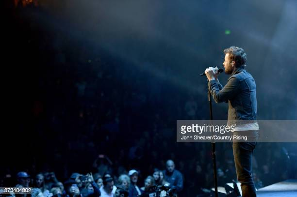 In this handout photo provided by The Country Rising Fund of The Community Foundation of Middle Tennessee singer Dierks Bentley performs onstage for...