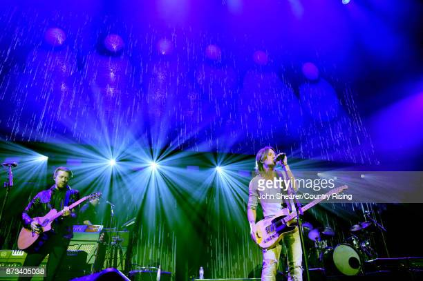 In this handout photo provided by The Country Rising Fund of The Community Foundation of Middle Tennessee musical artist Keith Urban performs onstage...