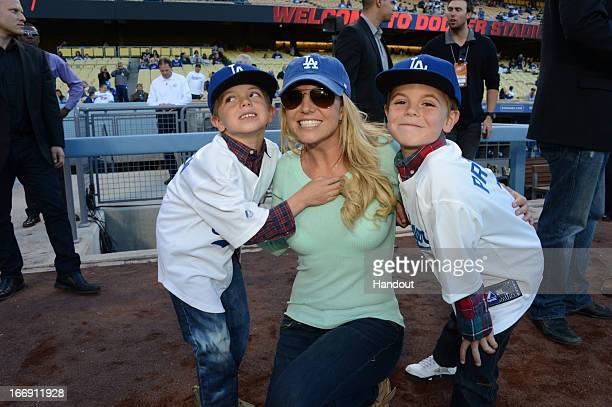 In this handout photo provided by the LA Dodgers Britney Spears poses with sons Jayden James Federline and Sean Preston Federline during a game...