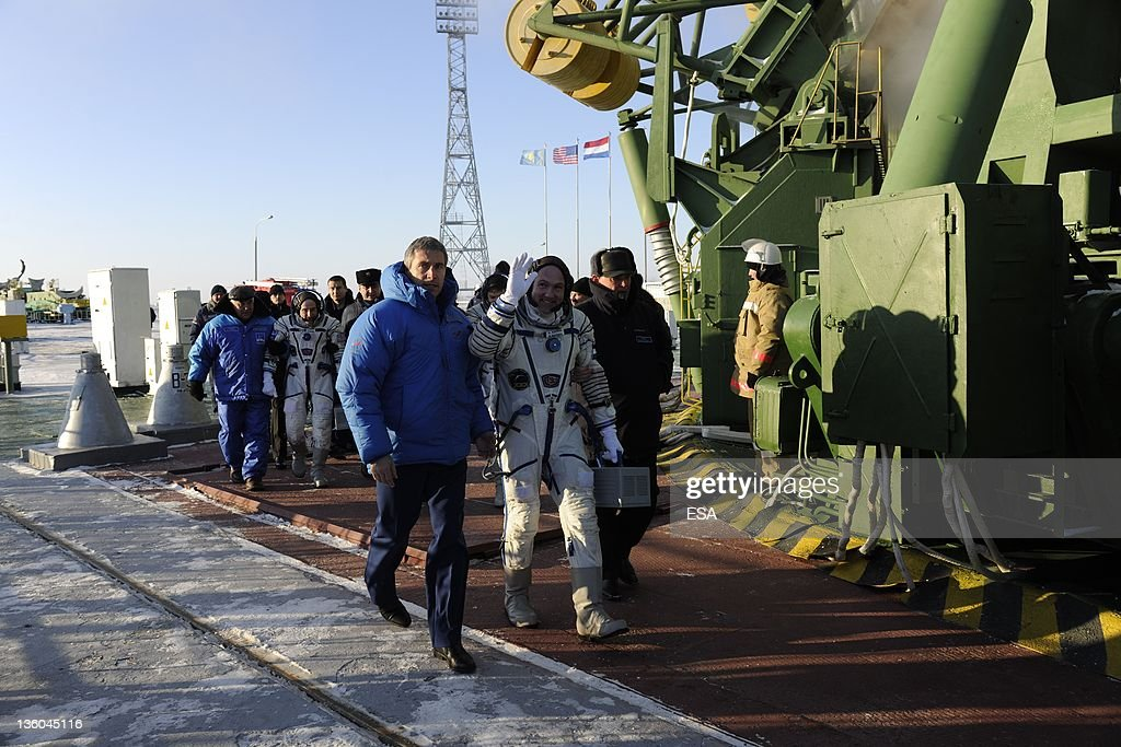 In this handout photo provided by the European Space Agency (ESA), ESA astronaut André Kuipers prepares to take the elevator to the top of the Soyuz rocket with Russian cosmonaut Oleg Kononenko and NASA astronaut Don Pettit on December 21, 2011 at Baikonur Cosmodrome in Kazakhstan. The Soyuz TMA-03M spacecraft is due to launch today from Baikonur Cosmodrome, ahead of a five month expedition to the International Space Station.