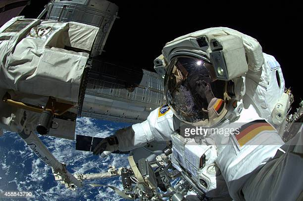 In this handout photo provided by the European Space Agency German ESA astronaut Alexander Gerst takes a 'selfie' during his spacewalk whilst aboard...
